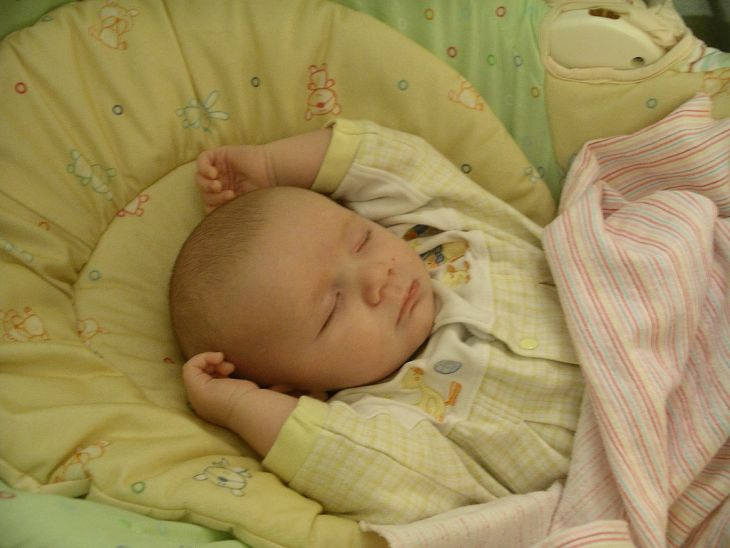 Babies sleeping with their arms up